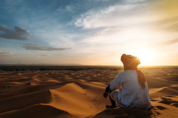 a man in the desert at sunset, image for advertising or copy space