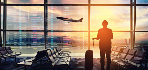 Silhouettes passenger airport. Airline travel concept. Wall mural