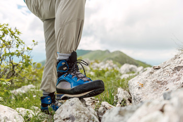 Hiker boot, standing on a rock