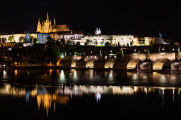 Wall Mural - Charles bridge, famous landmark and travel destination at night in Prague, Czech Republic