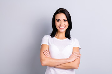 Portrait of her she nice-looking attractive lovely winsome shine glad cheerful optimistic girl folded arms isolated over light gray background
