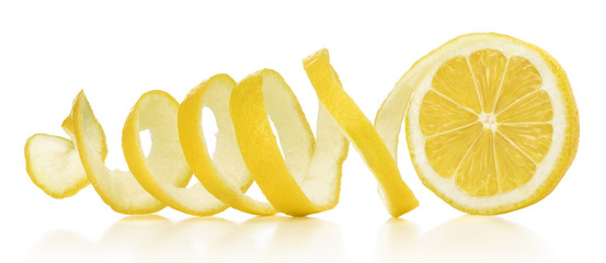 The lemon skin is twisted in a spiral with reflection on an isolated white background Fototapete