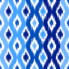 Uzbek ikat silk fabric pattern, indigo blue and white colors.