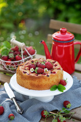 cake with fresh strawberry on wooden table, outdoor