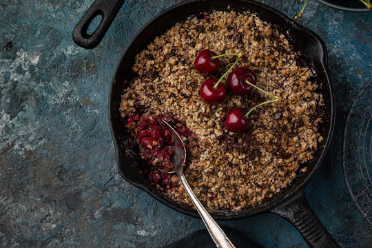 cherry and chocolate crumble pie on cast iron pan