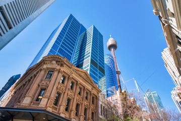 SYDNEY - AUGUST 18, 2018: City buildings in Pitt Street, skyward view. Sydney attracts 20 million tourists annually Fotobehang