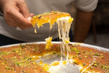 "Arabic sweet ""Konafa"" or ""Knafeh"" with white cheese and pistachio"