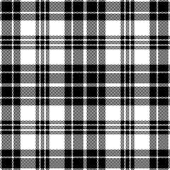 Black and white tartan plaid pattern. Flannel textile pattern / seamless background.