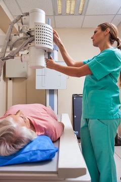 Senior retired woman undergoing medical test under expert female doctor supervision