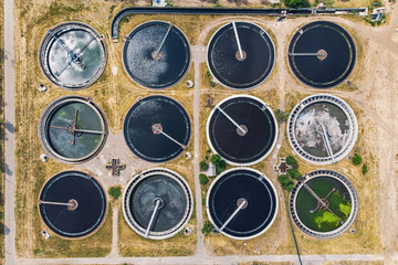 Modern urban wastewater and sewage treatment plant, aerial top view