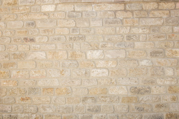 Old beige brick wall background texture close up Wall mural