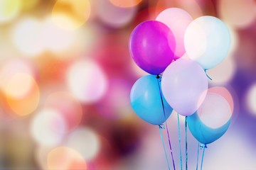 Bunch of colorful balloons on abstract background