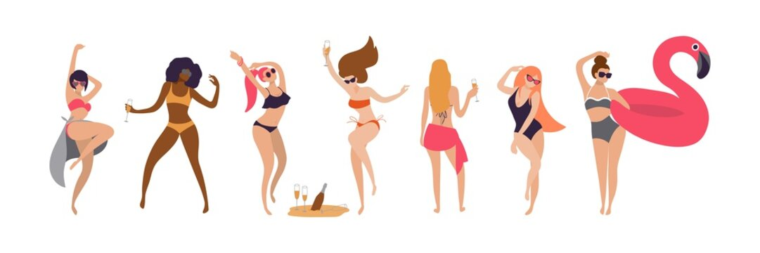 happy young women dancing at a beach party