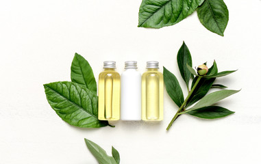 Spa concept with massage lotion and essential oils