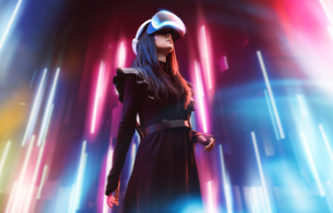 Wall Mural - Beautiful woman in futuristic dress over dark background. Girl in glasses of virtual reality. Augmented reality, game, future technology, robots and people concept. VR. Neon light.
