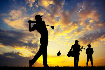 golf players at sunset