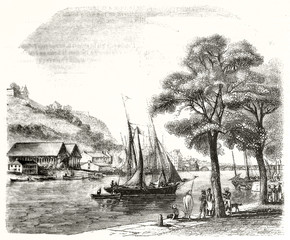 Vintage etching style landscape focused on a old sailboat docked on a peaceful port inside a gulf. Saint-Esprit area Bayonne France. By Morel-Fatio publ. on Magasin Pittoresque Paris 1848