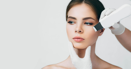 Fototapeta shot of woman's face while procedure ultrasound cavitation, facial peeling obraz