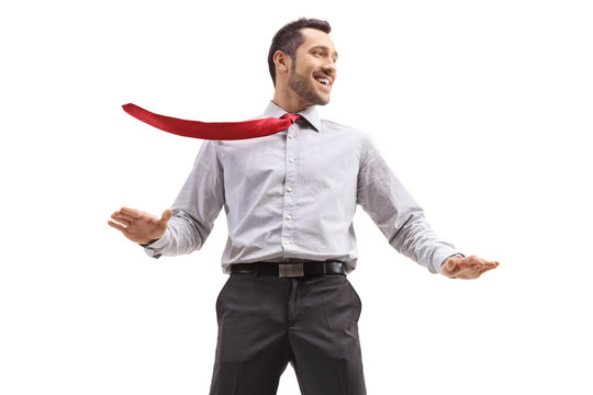 Cheerful young businessman ith his tie blown by wind