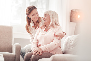 Amazing mother and daughter smiling tenderly to each other Wall mural