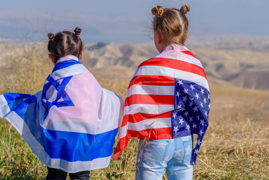 Two cute girls with American and Israeli flags.