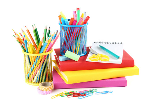 School supplies with books on white background
