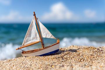 Miniature fishing boat at beach