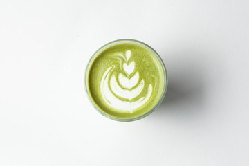 Green japanese matcha latte with hot milk for breakfast isolated on white background