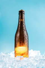 closed brown glass beer bottle on ice