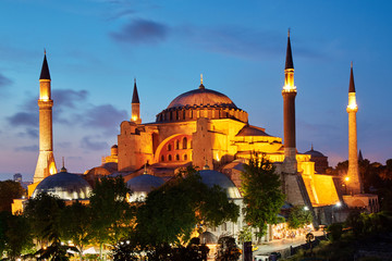 Hagia Sophia at night, Istanbul, Turkey. It is a top landmark of Istanbul. Panoramic view of the ancient Hagia Sophia or Aya Sofya in evening. Old architecture of Istanbul, formerly Constantinople.