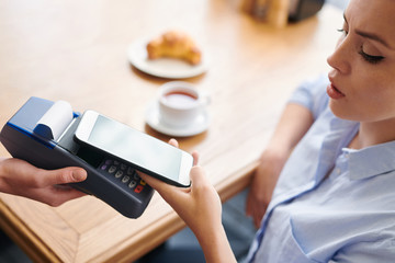 Paying with smartphone in restaurant