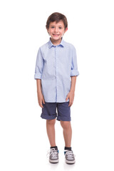 Boy standing smiling on a white background