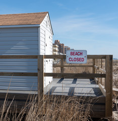 Beach Closed Sign on Wooden Fence