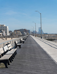 Boardwalk Lined with Benches with Skyline in Background