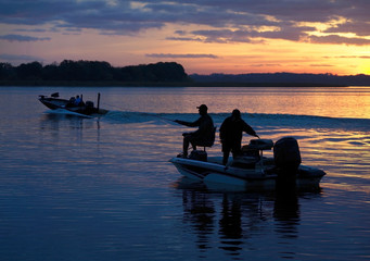 Silhouetted Fisherman Heading Out to Fish as the Sun Comes Up in a Beautiful Sunrise