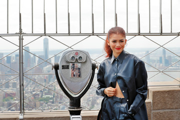 Actor Zendaya poses for a photograph on top of the Empire State Building to promote the film, Spider-Man: Far From Home in New York