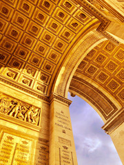 """France, Paris - 6.10 2019: The Arc de Triomphe - a monument in the 8th arrondissement of Paris in the Place Charles de Gaulle, by order of Napoleon to commemorate the victories of his """"Great Army""""."""