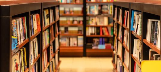 Fototapeta various books on shelves at local book store obraz