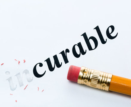 Word  incurable and curable with eraser close-up