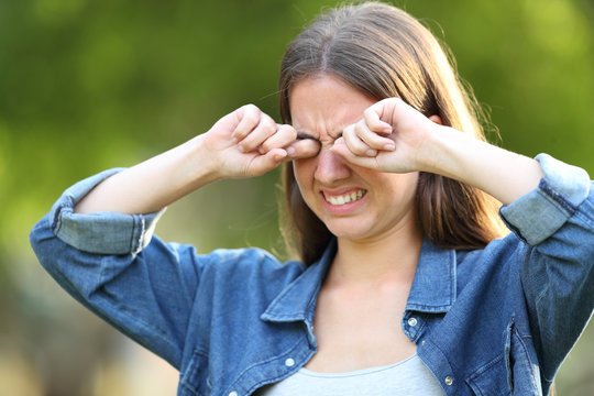 Woman suffering itching scratching eyes