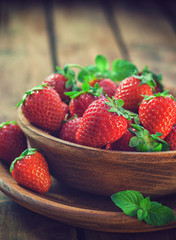 Fresh sweet strawberries on wooden bowl