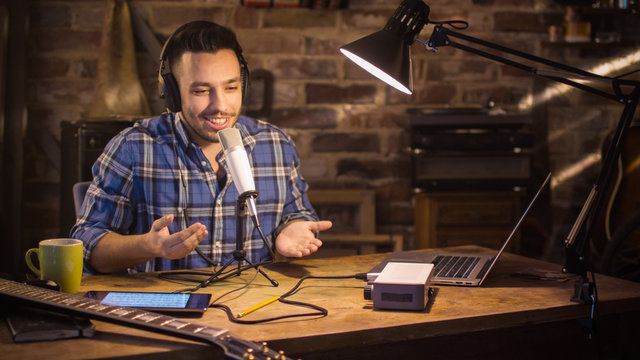 Young man makes a podcast audio recording at home in a garage.