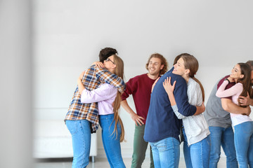Fotomurales - Hugging young people at group therapy session