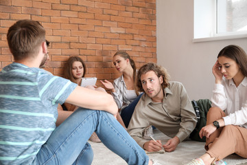 Fotomurales - Young people with psychologist at group therapy session