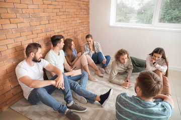 Fotomurales - Young people at group therapy session