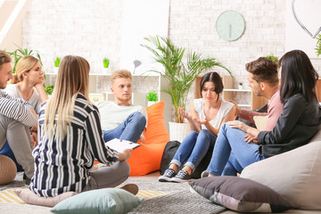 Fotomurales - People calming woman at group therapy session