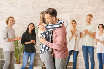 Fotomurales - People hugging at group therapy session