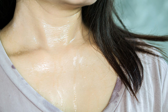 woman neck sweat skin closeup