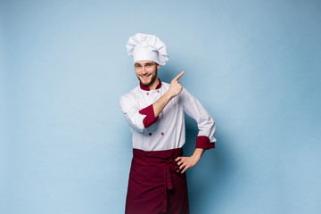 Chef presenting something over light blue background