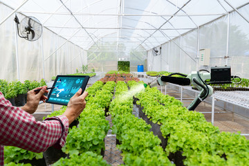 Automatic agricultural technology robot arm watering plants tree